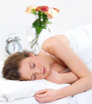 Woman Sleeping well with uep 77 Sleeping Plugs - snoring partner will not affect her sleep